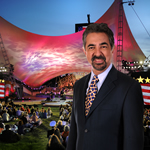 Image of Joe Mantegna standing in front of concert stage