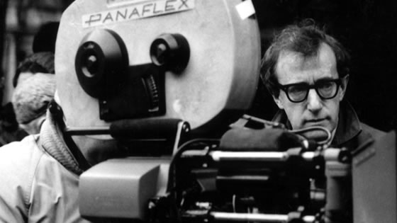 Photo of Woody Allen behind film camera