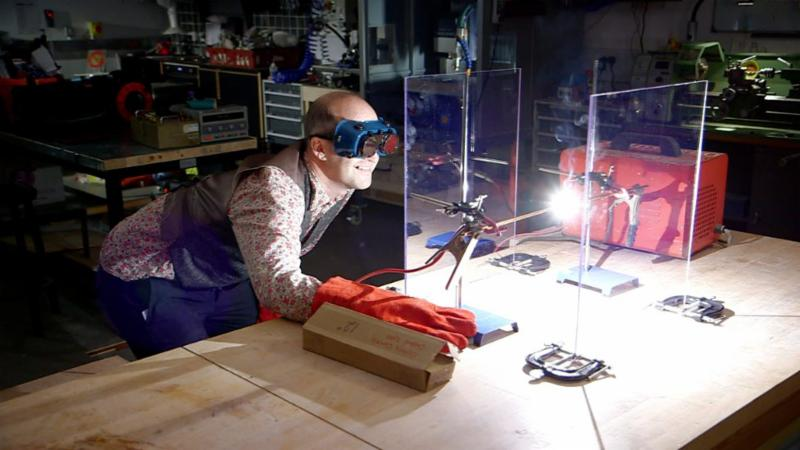 man conducting welding experiment