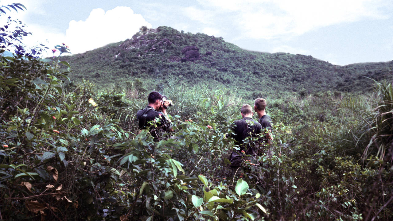 Spc. Bill Foulke filming the platoon leader and platoon sergeant checking coordinates.