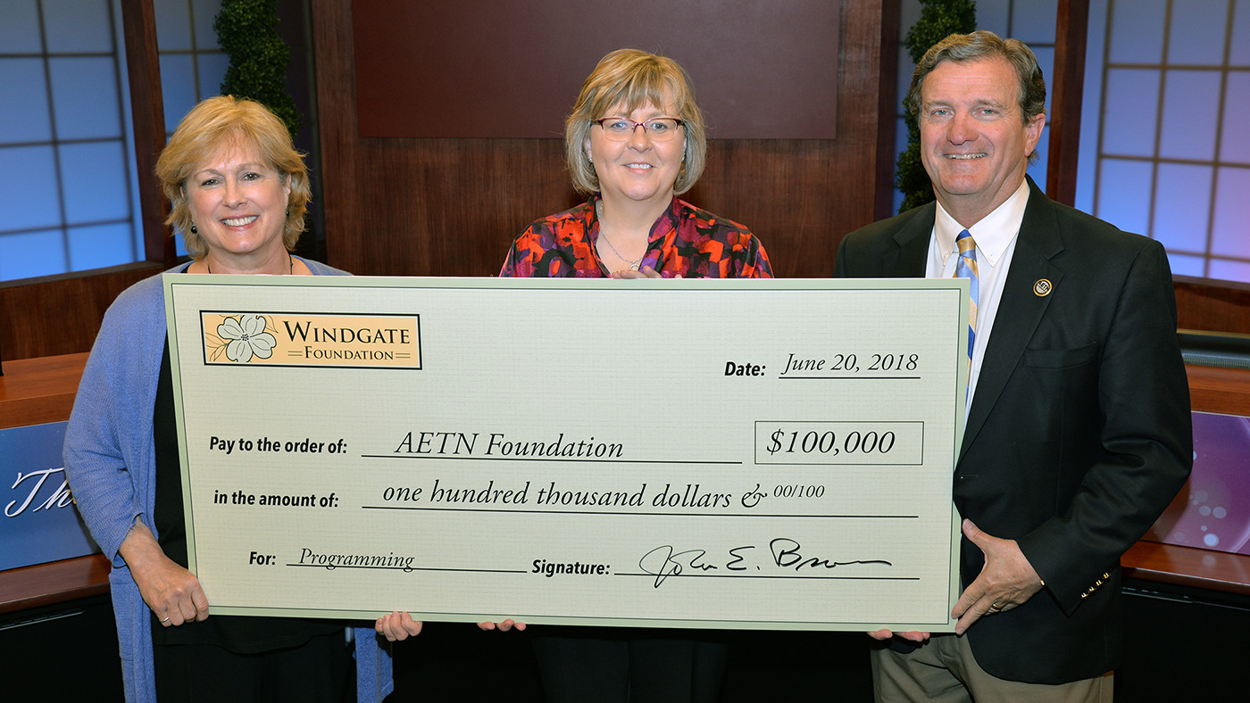 AETN Leadership holding giant check