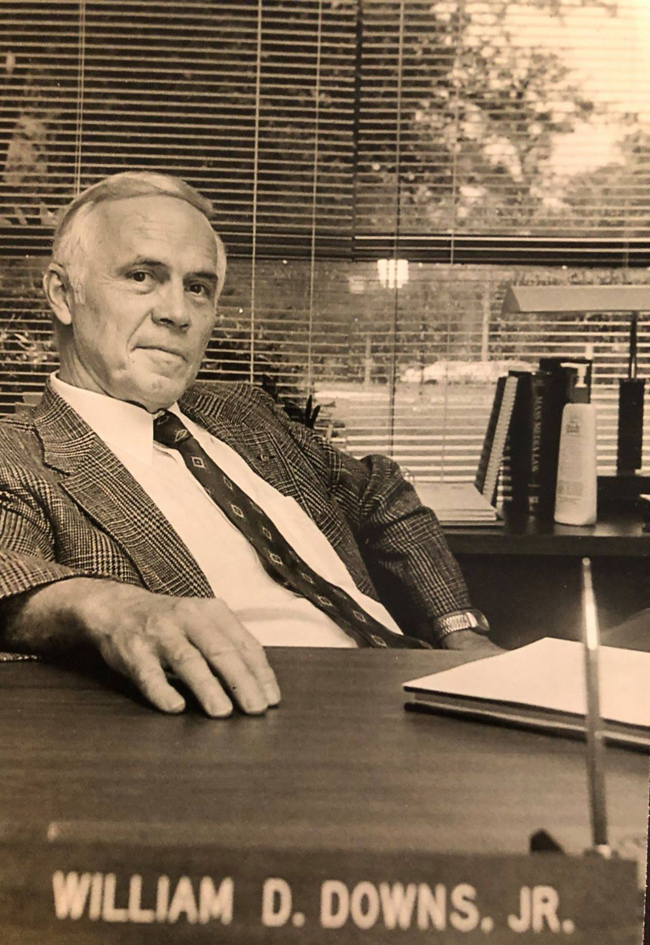 Dr. Downs at his desk, Ouachita Baptist University, courtesy of the Downs family.