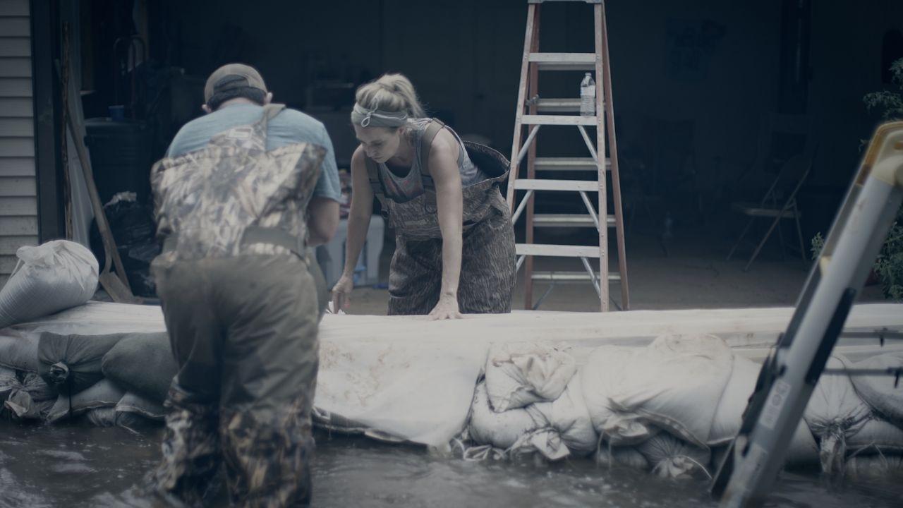 Volunteers Work on the Sandbag Wall