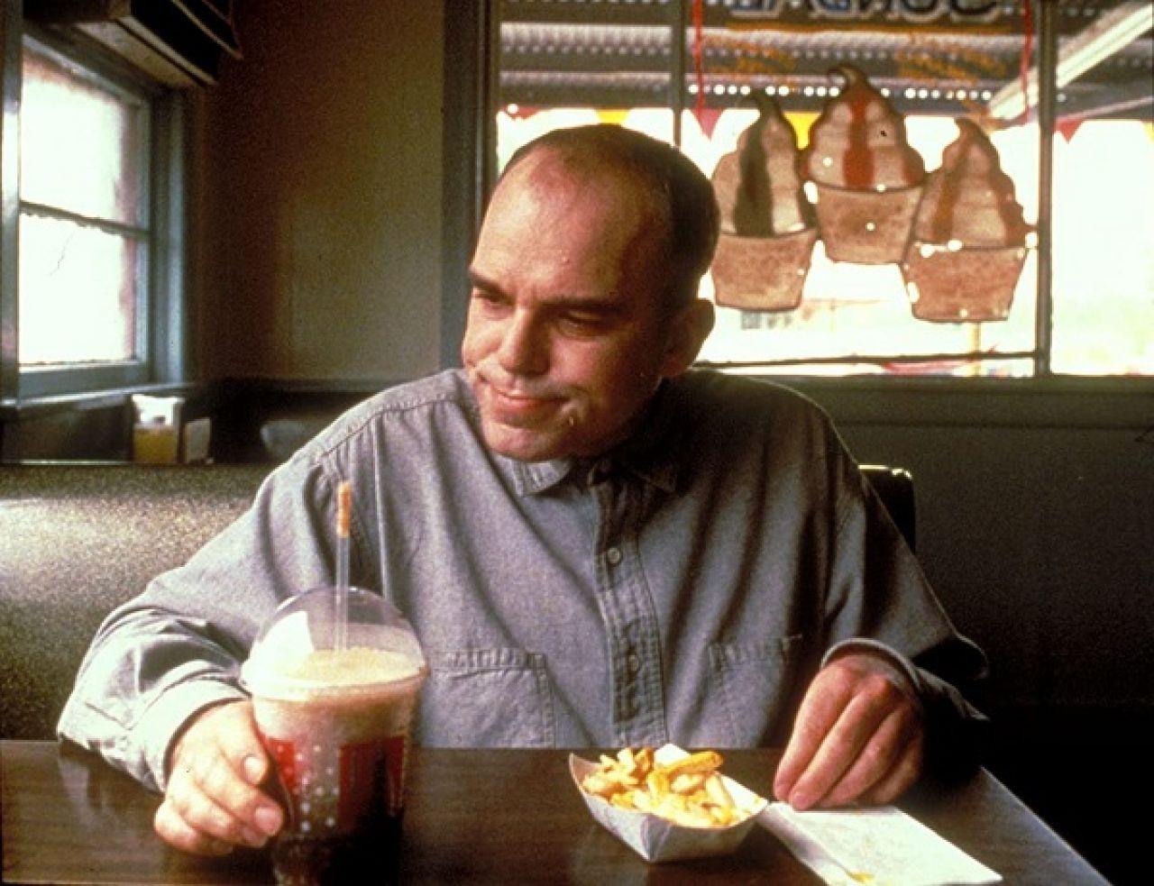 Still of Billy Bob Thornton as Karl Childers eating at Garry's Slingblade Diner in Sling Blade Film