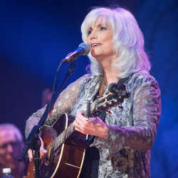 Emmylou Harris performing on stage