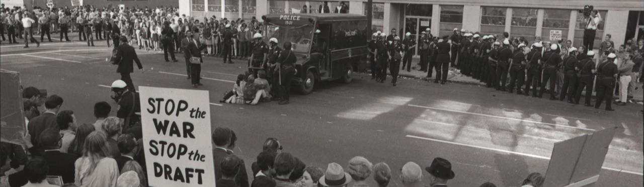 Antiwar protestors gather outside an Army induction center. Oakland, CA, October 17, 1967.