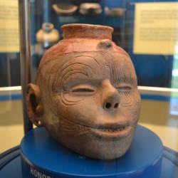 ancient pottery design as human head