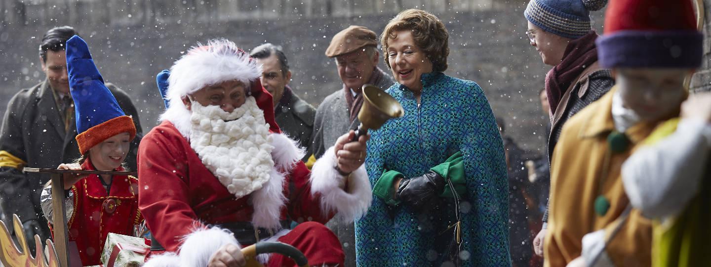 Santa riding through crowd while it's snowing