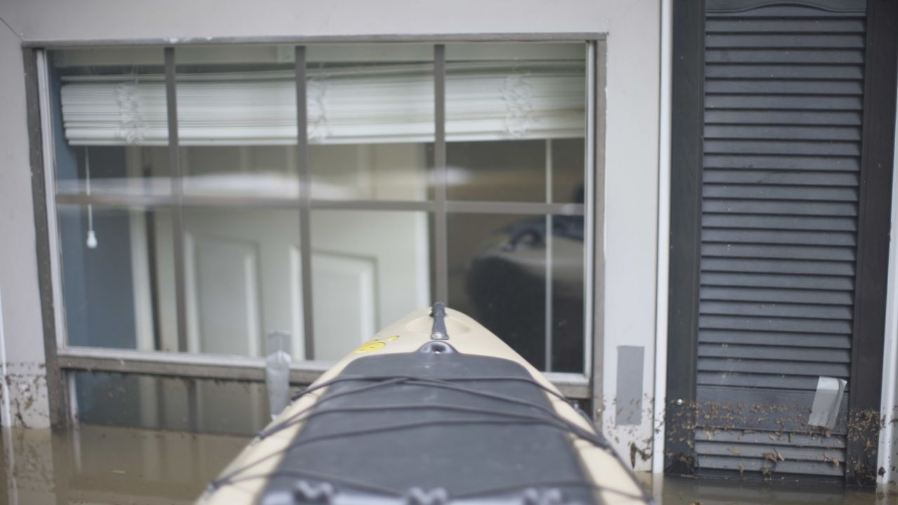 The Exploring Arkansas Kayak floats at the window of a Treasure Hills Home