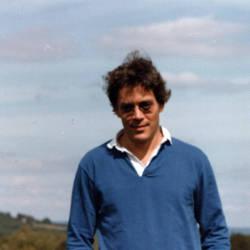 Raul Julia wearing sunglasses