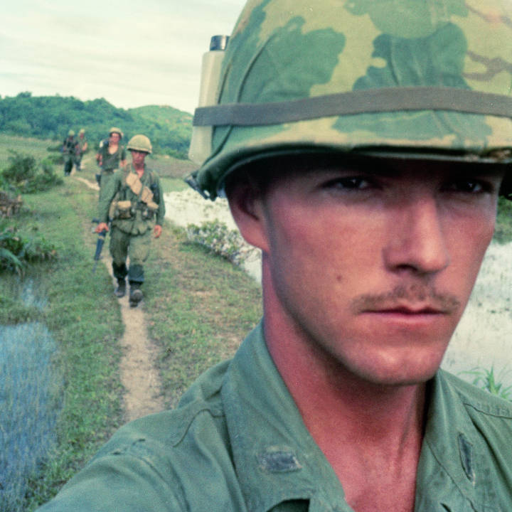 1st Lt. Bruce Wesson with troops of the 196th Light Infantry. Brigade in background.