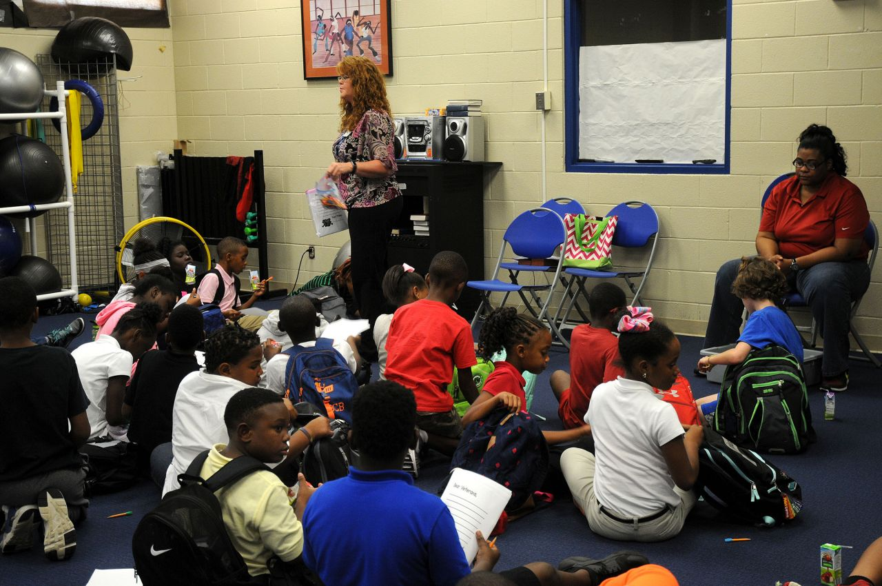 "Amanda Colclasure presents The Reading Brigade's ""The Wall"" session to students."