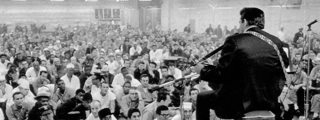 Johnny Cash performing on stage at Folsom Prison