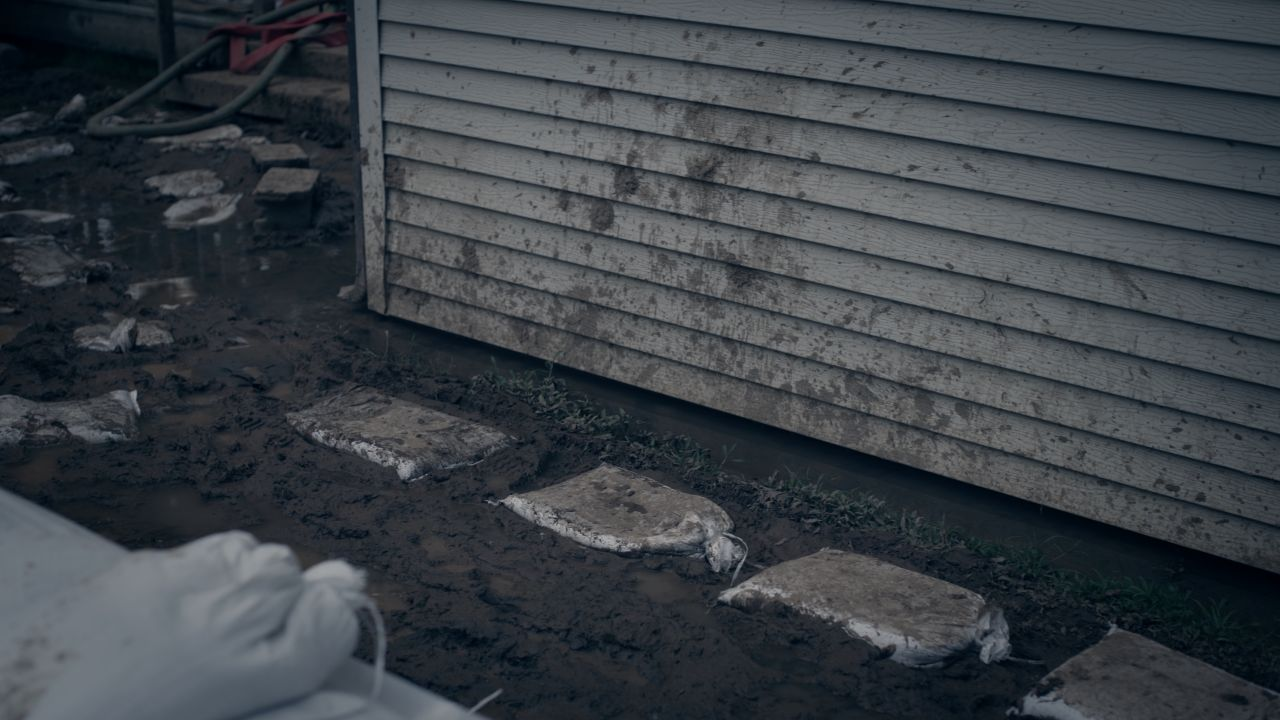 Spattered Mud Is the Only Evidence of a Near-Breach at the Johnson Home
