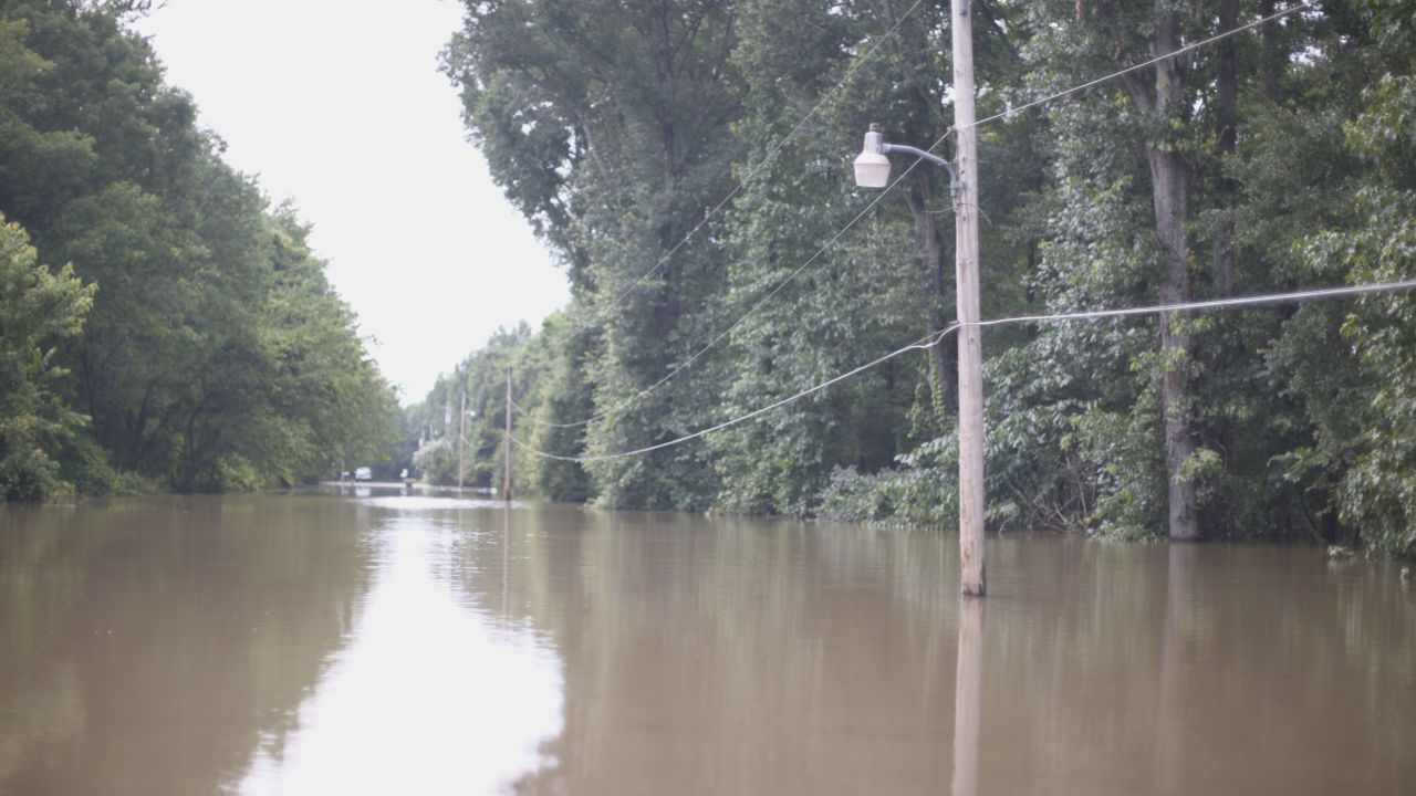 The power lines are strangely close above the water near Cadron Creek