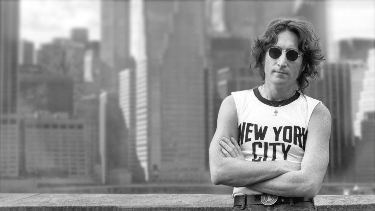 John Lennon in New York tank in front of New York City skyline