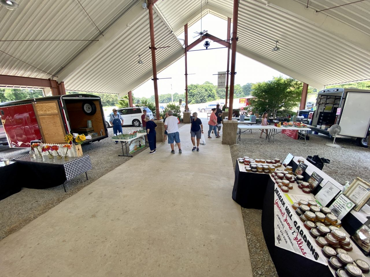 Wide view of the ASU Regional Farmers Market Pavilion and the booths within