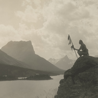 Blackfeet Native American looking out over St. Mary Lake at Glacier National Park