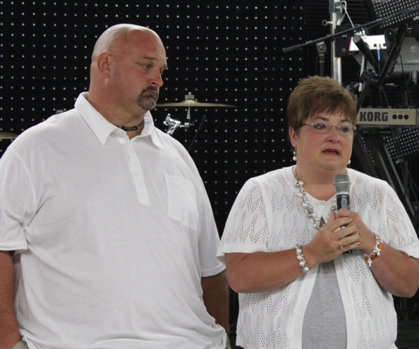 Mark and Tina Davenport speaking at one of Kendrick Fincher Hydration for Life's events