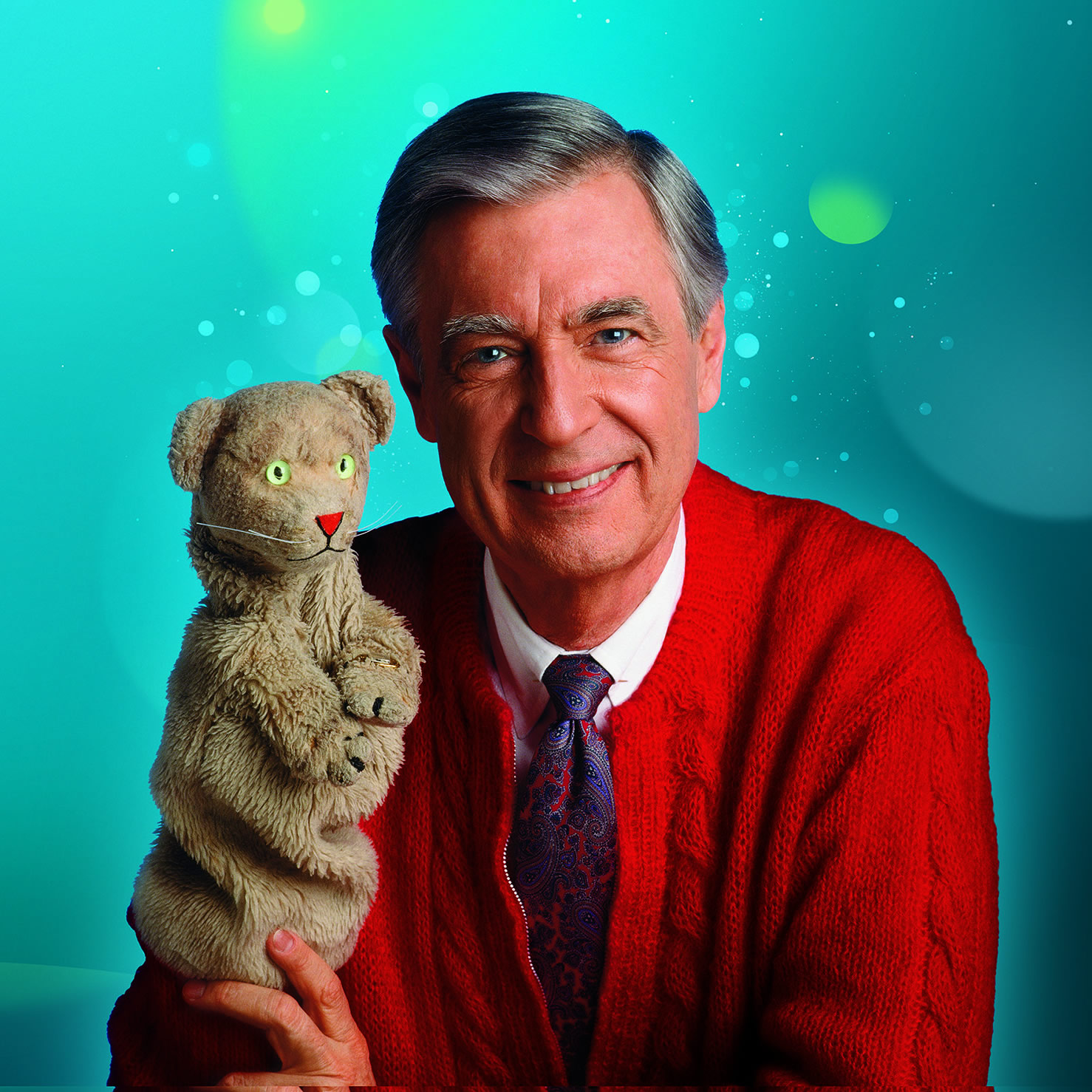 Mr. Rogers posing with Daniel Tiger