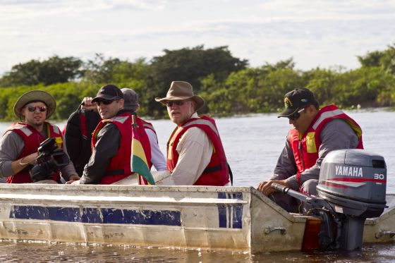 "he Mineral Explorers crew, accompanied by a member of the Bolivian Navy, right, travels through the Pantanal wetlands to the Anahi Mine during the filming of ""Mineral Explorers - Bolivia"" in May 2012."
