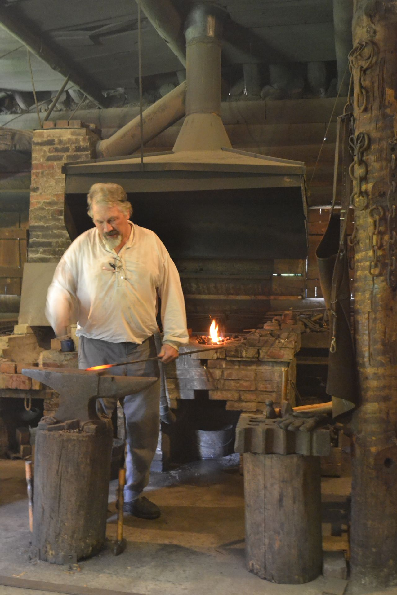 A blacksmith in Historic Washington State Park forges a Bowie knife.