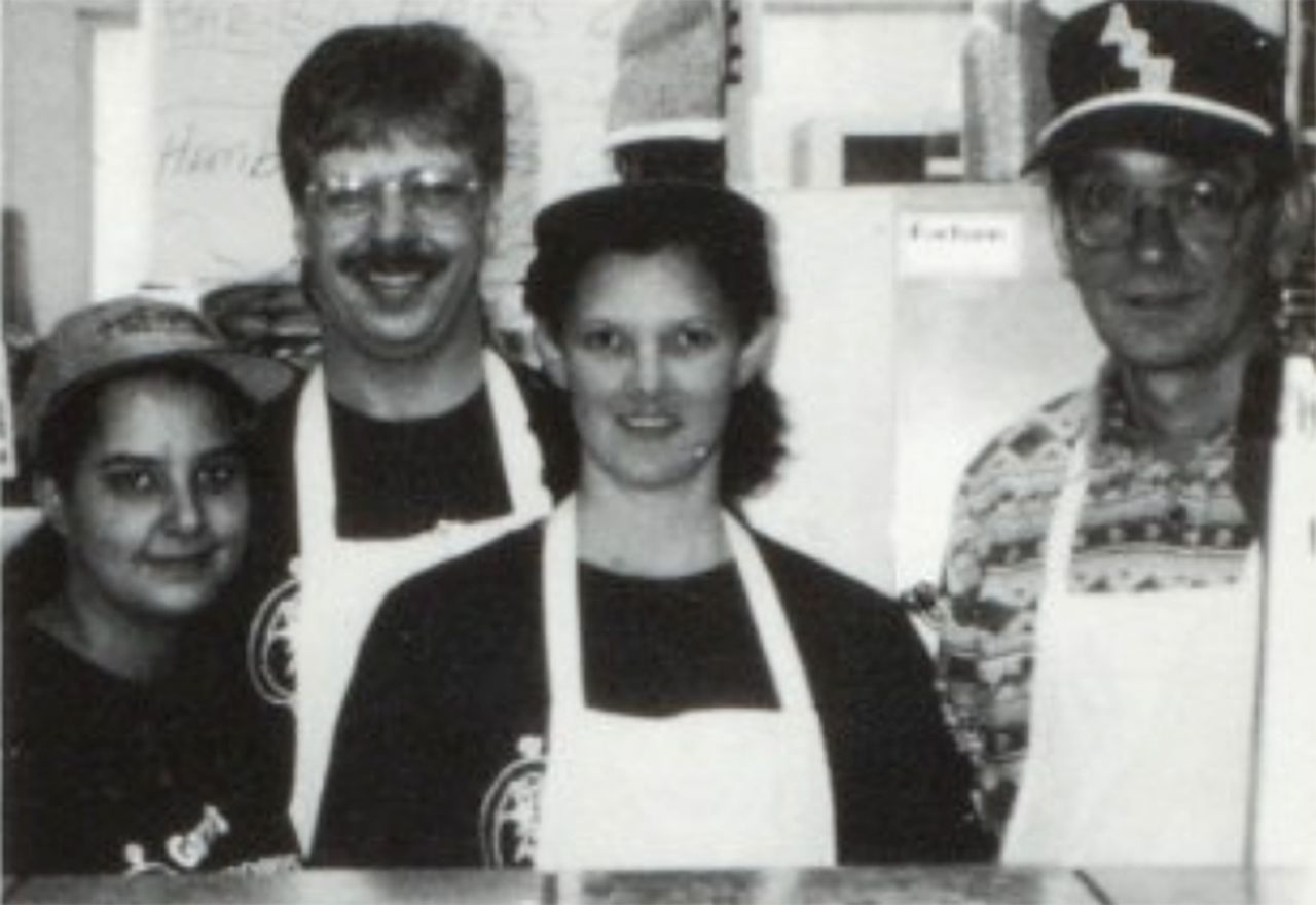 Staff members pose behind the counter of Garry's Drive In in the late 1990s