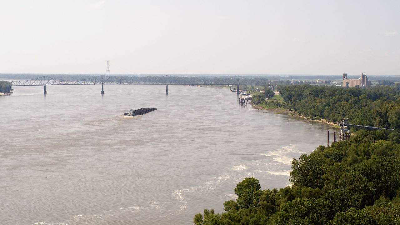 Aerial view of the Mississippi River and Helena River Park with the river bridge in the background