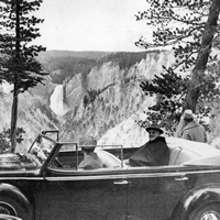 Franklin Delano Roosevelt sitting in car at park