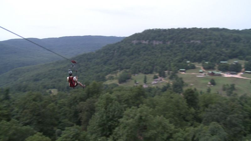 Exploring Arkansas - Chuck rides the Iron Horse zipline at Horseshoe Canyon Ranch.