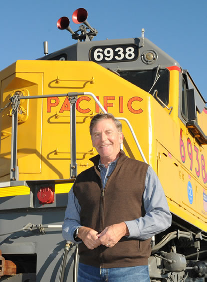 Tommy Sanders standing in front of train
