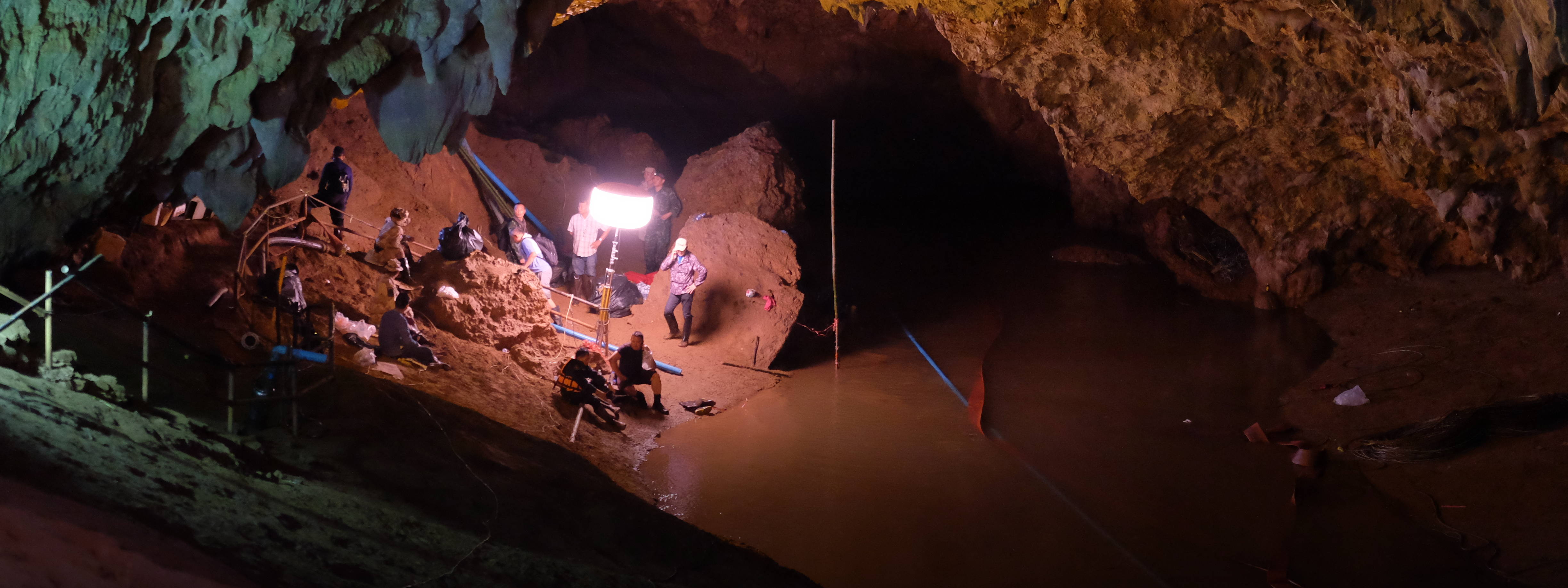 workers in dark, watery cave