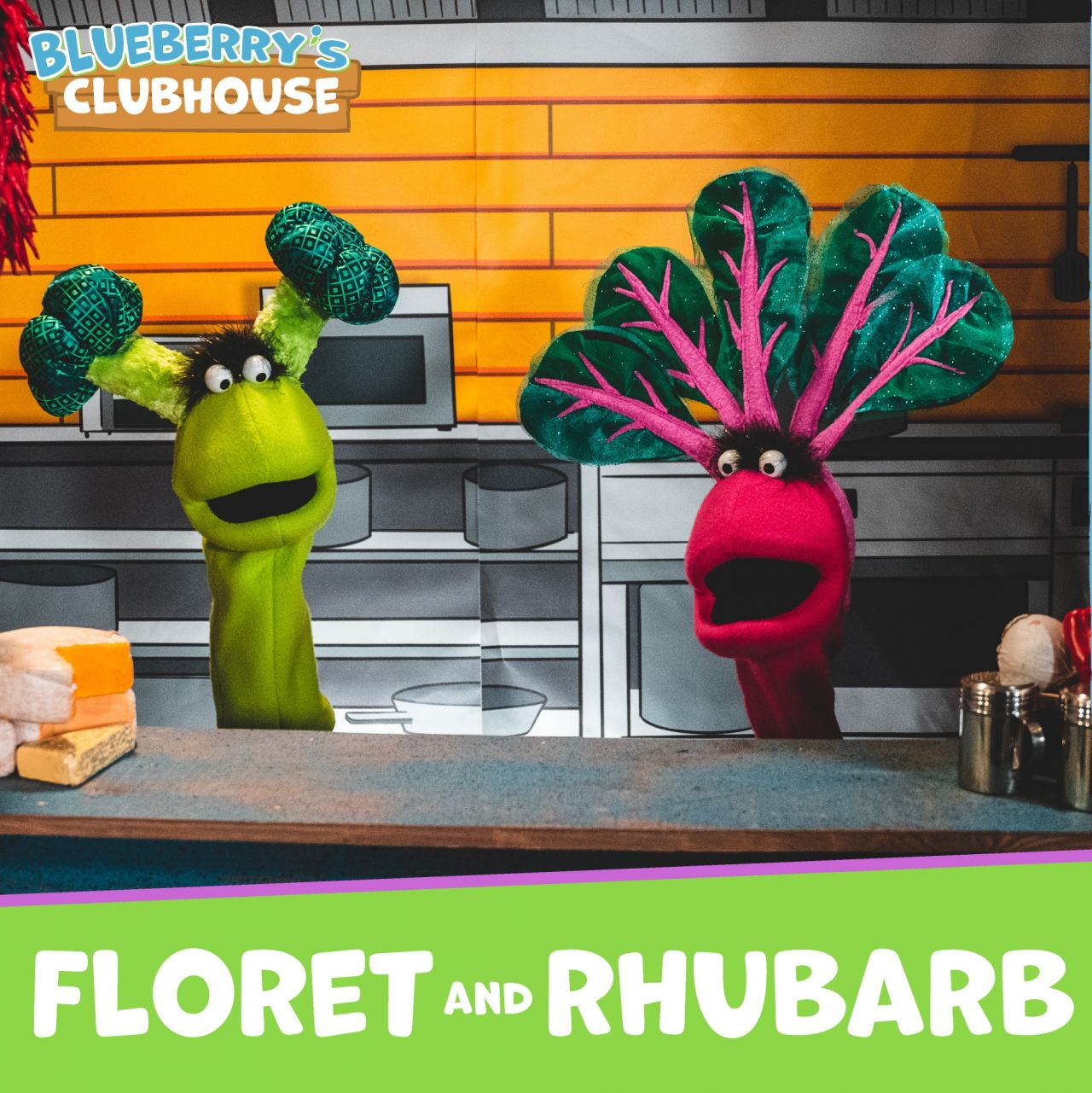 Floret and Rhurbab Puppets stand behind kitchen counter