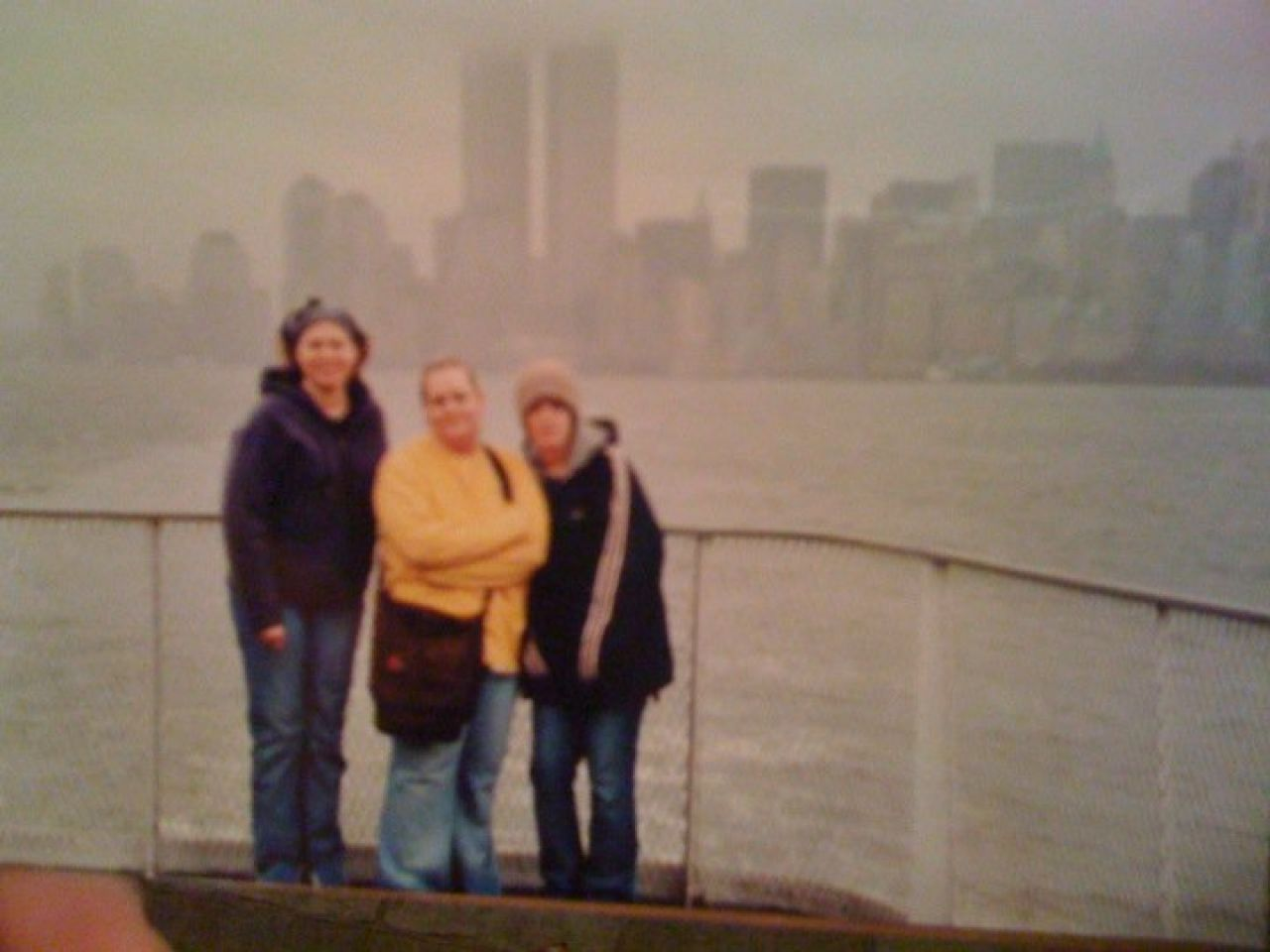 Jennifer Gibson and friends pose along the New York City skyline with the World Trade Center Towers in the background