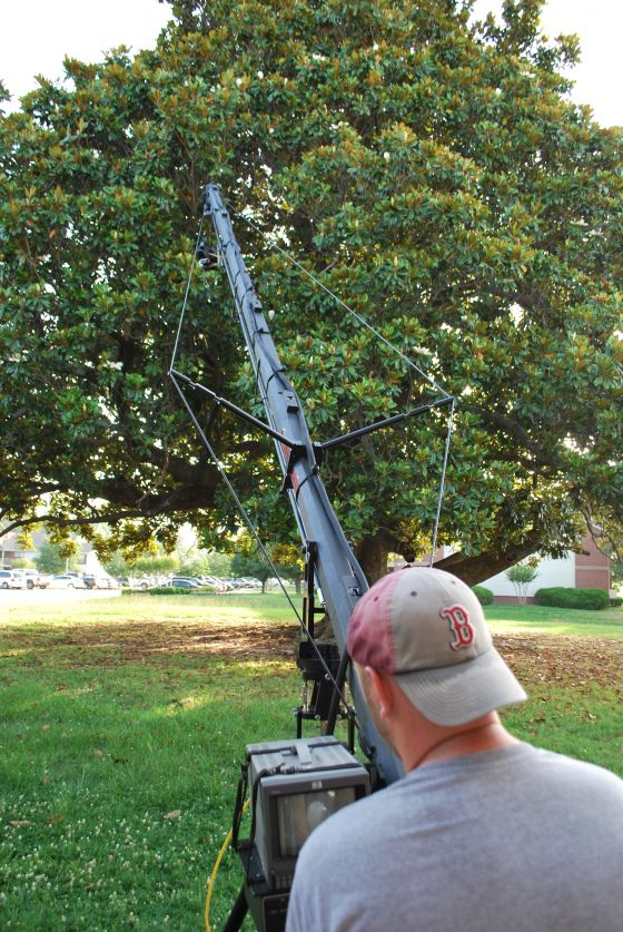Our awesome cameraman, Jeffery James, breaks out the big guns (aka a jib crane) for the shoot.