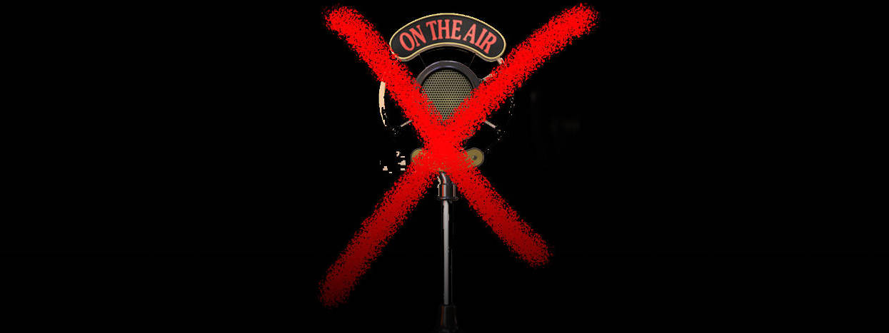 A radio microphone with an x spray-painted across it.