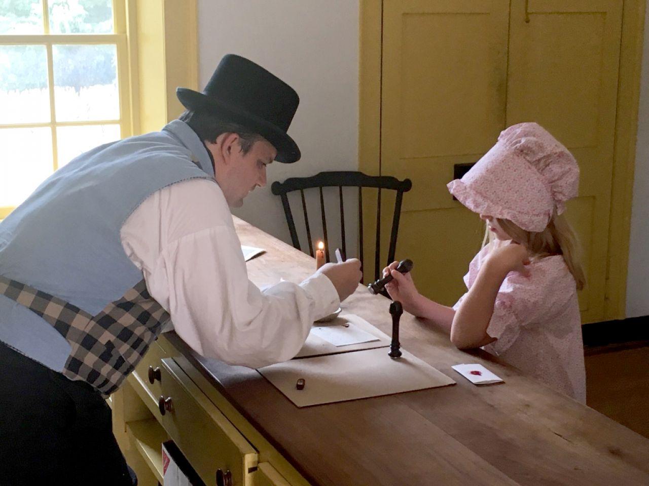 Historic Arkansa Museum Little Women Sealing Letters 1