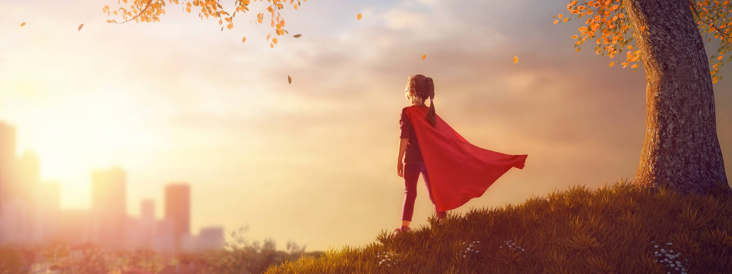 artwork child with super hero cape looking over city