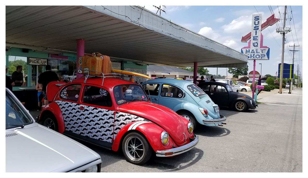 Classic Volkswagon Bugs lined up underneath the Susie Q Awning
