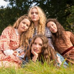 The cast of Little Women huddeled together