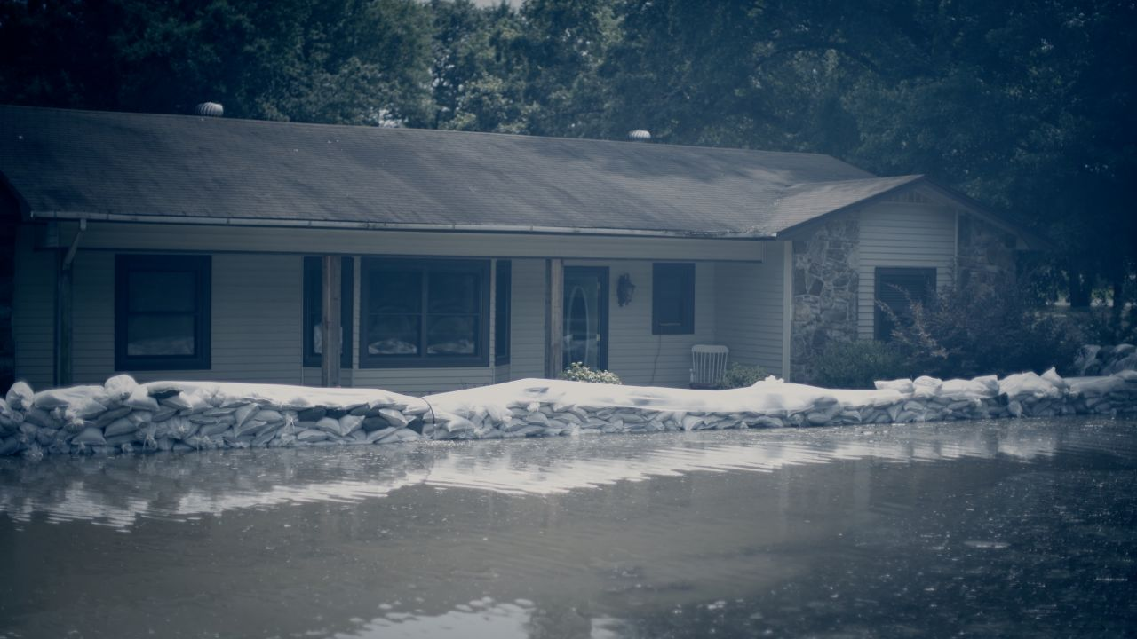 The Johnson's home, surrounded by flood waters