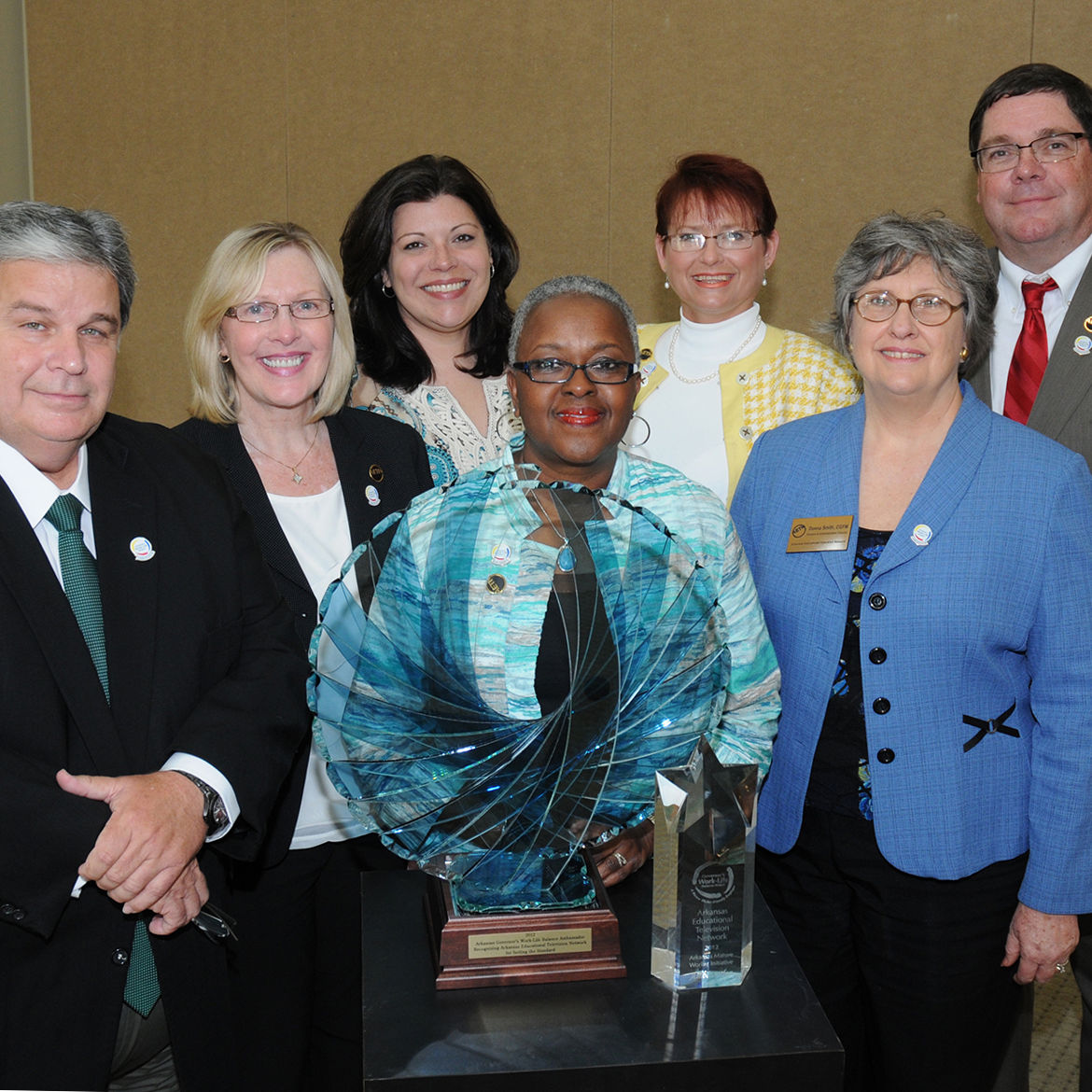 AETN Administration Accepting Award