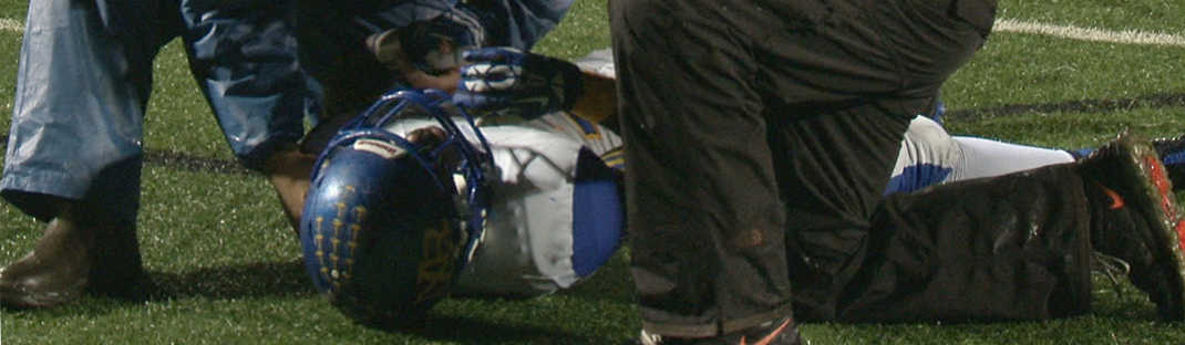 football player lying on field