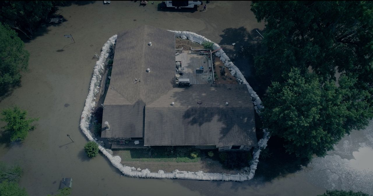 Aerial of the Johnson's home, surrounded by flood waters