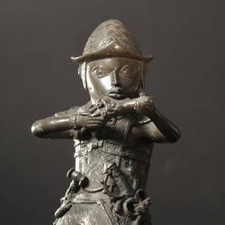 An ancient sculpture of a man.