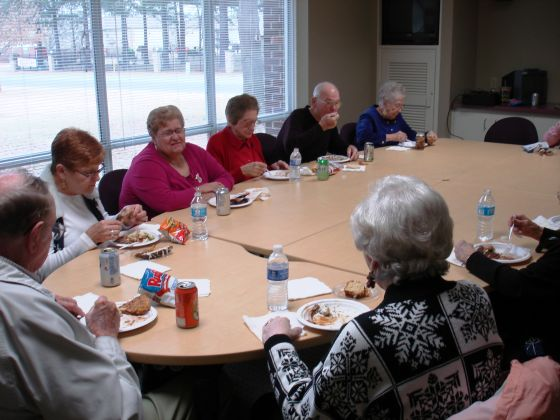 Volunteers sit down to their meal at the annual Arkansas PBS Foundaion Volunteer Potluck.