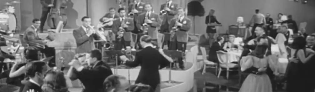 Old photo of big band playing with nicely dressed couples dancing