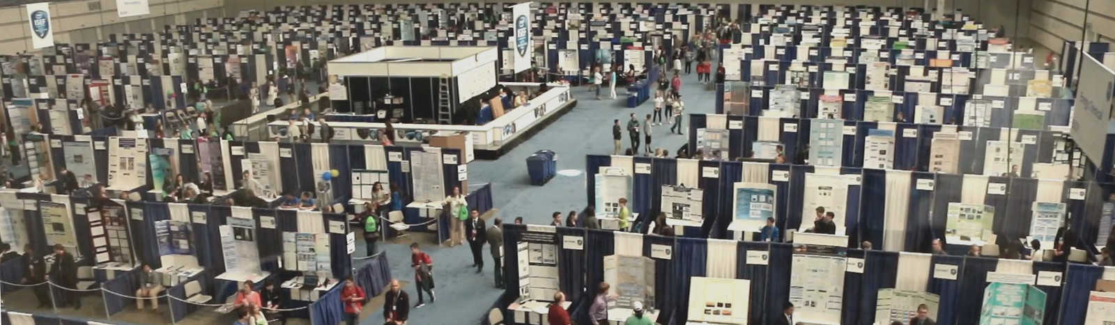 an event hall field with science fair booths
