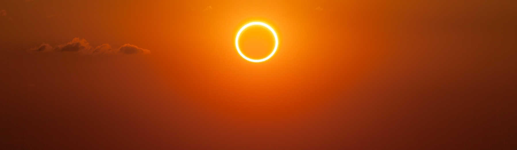 a solar eclipse in the sky