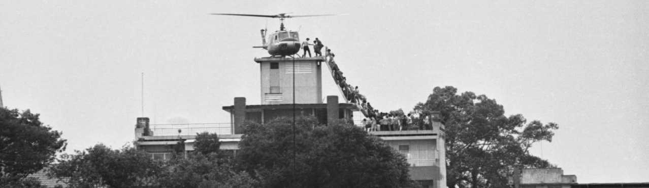 South Vietnamese civilians scramble to board a helicopter during the evacuation of Saigon. April 29, 1975.